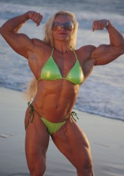 Amazing Muscle Babe posing outdoors