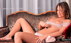 Sexy babe undressing pussy on couch