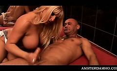 Blonde big titted Amsterdam sex queen giving hot tugjob