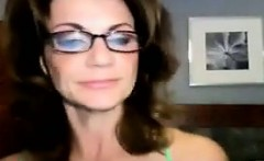 MILF With Glasses Licking Up Her Dildo