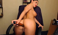 Babe Slides a Huge Dildo in her Ass
