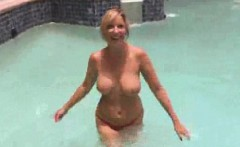 Tall blonde MILF shows off her big tits