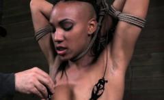 Nipple punished ebony sub caned