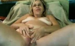 Hot mature milf rubs and fingers her pussy on webcam