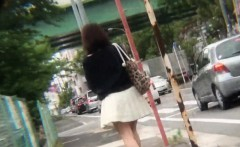 Asian Pee Slut Urinates On The Street