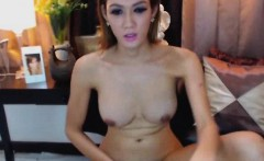 Gorgeous busty shemale is bare naked on cam masturbating
