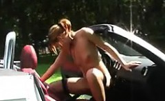 Squirting On A Cars Gear Shift Outdoors