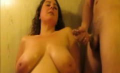 Amateur MILF with huge tits stroking a cock