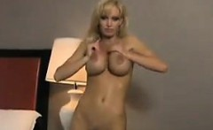 Busty Blonde Babe Doing A Striptease
