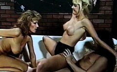Two busty blonde sluts sharing cock in a threeway