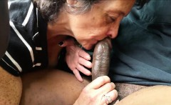 Grandma eating a lenghty black meatstick