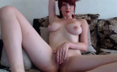 Buxom young redhead loses her tight panties and fingers her
