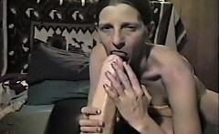 Slim woman fucking a dildo that is major