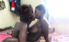 Two horny black sluts sharing one big dildo