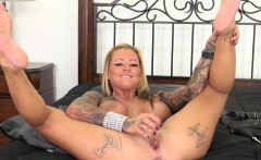 Tattooed nympho with big boobs Britney Shannon masturbates on the bed