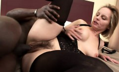 Horny blonde milf in lingerie has a black stud banging her hairy cunt