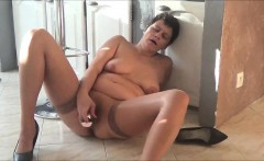 Horny Grandma pleasing herself with her toy