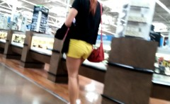 Sexy shopper with a luscious ass in bright yellow shorts is