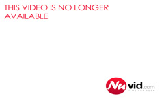 Red-haired bimbo lies on her bed and displays her hot breas