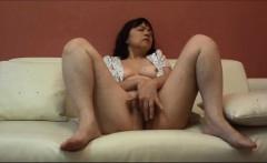 Horny Japanese milf Kui Somya fingering on the sofa