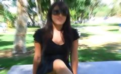 Sexy Asian is outside on a park bench showing off her