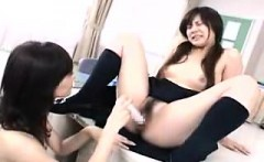 Pigtailed Japanese teen gets schooled in lesbian sex in the