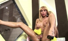 Big titted blonde tranny oils up her nipples and wanks off