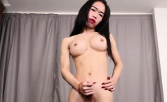 Busty ladyboy wanks cock and spreads ass solo