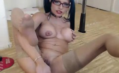 sexy brunette babe in lingerie and stockings toys her pussy