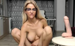 excited big titted blonde plays with her pussyon cam