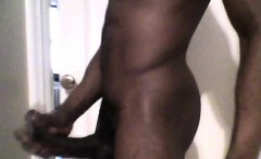 Black man jerks off his big curved cock