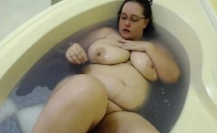 two brunette bbw are in the shower