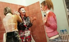 Lesbo wild trio playing in messy cream in the toilet