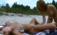 lesbian women undressing each other
