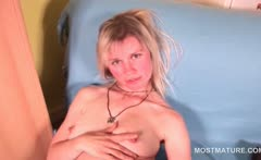 Topless mature blonde in fishnets teasing her pussy