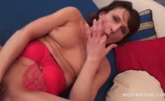 Slim sexy mature fucking herself with a vibrator in close-up