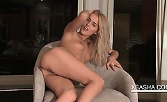 Blonde Sasha flashing her little cunt in close-up