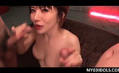 Bitchy Japanese hottie sucking on two mushroom heads