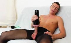 Gay guy teasing his cock in panty-hose