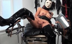 Sexy brunette babe with mask gets horny