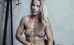 Muscle Cougar Plays With Her Wet Pussy