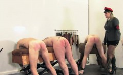 Mature prodomme caning her slaves asses