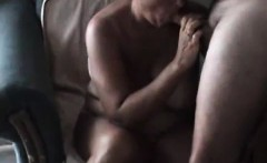 Saggy tit old bitch sits on a chair while she gives hubby a