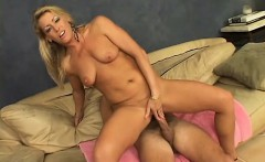 Sultry blonde milf with big boobs rides a hard shaft with excitement