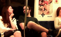 Hot redheaded chick gets seduced by a nerdy dude on the tra