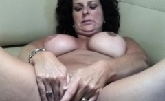 Lustful mature lady with big tits spreads her hot legs and