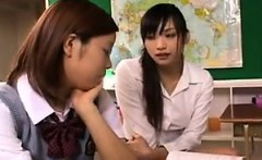 Alluring Japanese teen gets schooled in lesbian sex in the