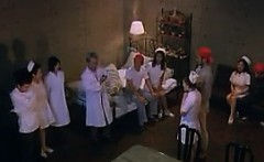 Attractive Japanese nurse bounces on a stiff cock until she
