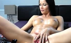 Curvy brunette milf brings out the toys and plays
