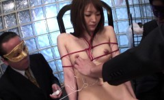 Masked guys have fun with tied up Asian's sensitive nipples